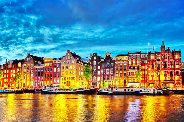 Famous Amstel river and night view of beautiful Amsterdam city. stock photo
