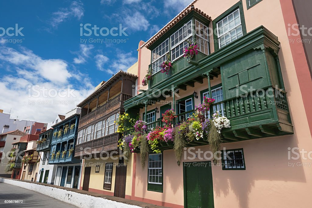 Famous ancient colorful colonial balconies decorated with flower stock photo
