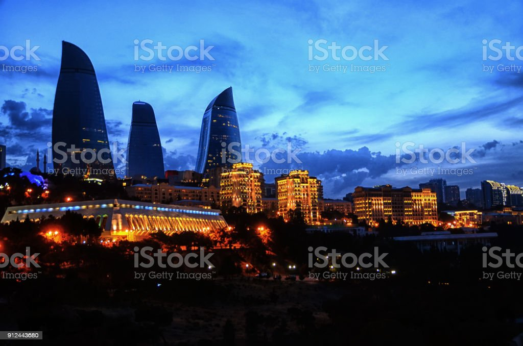 Famous and Beautiful evening view of skyscrapers. Baku City international business center. Flame towers at evening. Baku, Azerbaijan . View to Flame towers, landmark of Baku, Azerbaijan stock photo