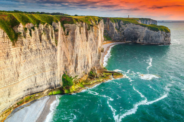 Famous beach and rocky coastline in Normandy region, Etretat, France Amazing rocky coastline and magical sunset, Etretat, Normandy, France, Europe normandy stock pictures, royalty-free photos & images