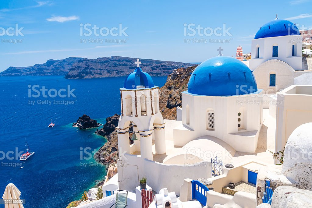 Famous blue dome churches in Oia stock photo