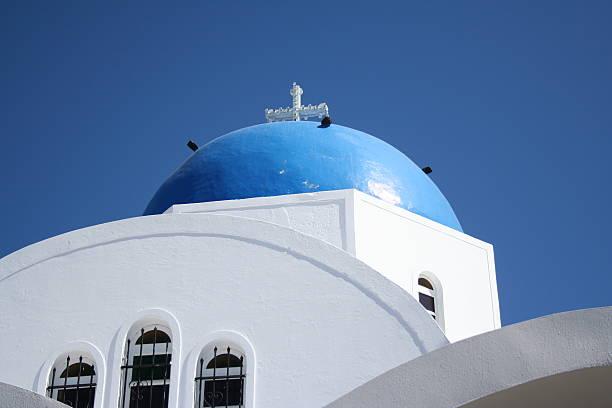 Famous Blue Dome on Church in Santorini Greece stock photo