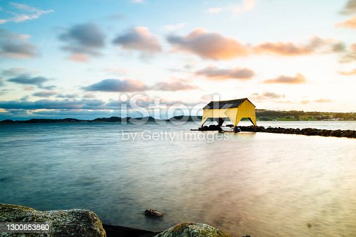 The famous yellow boathouse at Sola in the sunset