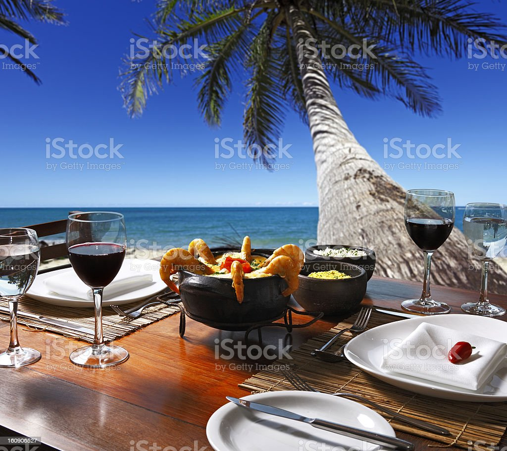 Famous Brazilian dish Moqueca served by the beach stock photo