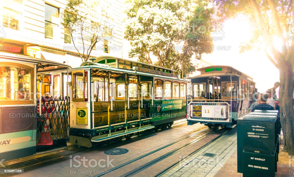 Famous Cable Cars at Powell & Market Station Turntable in San Francisco, California. Powell-Hyde line train. Picture with vintage look stock photo