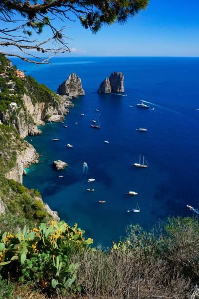 Famous Capri island's faraglioni seen from Punta Cannone stock photo