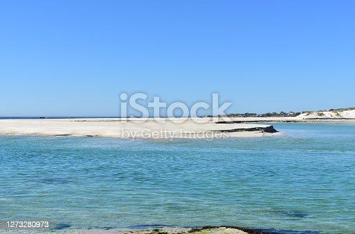 Praia de Carnota or Playa de Carnota. Rias Baixas, A Coruña Province, Galicia Region, Spain, Europe. Beach with lake, turquoise water, sand dunes and blue sky.