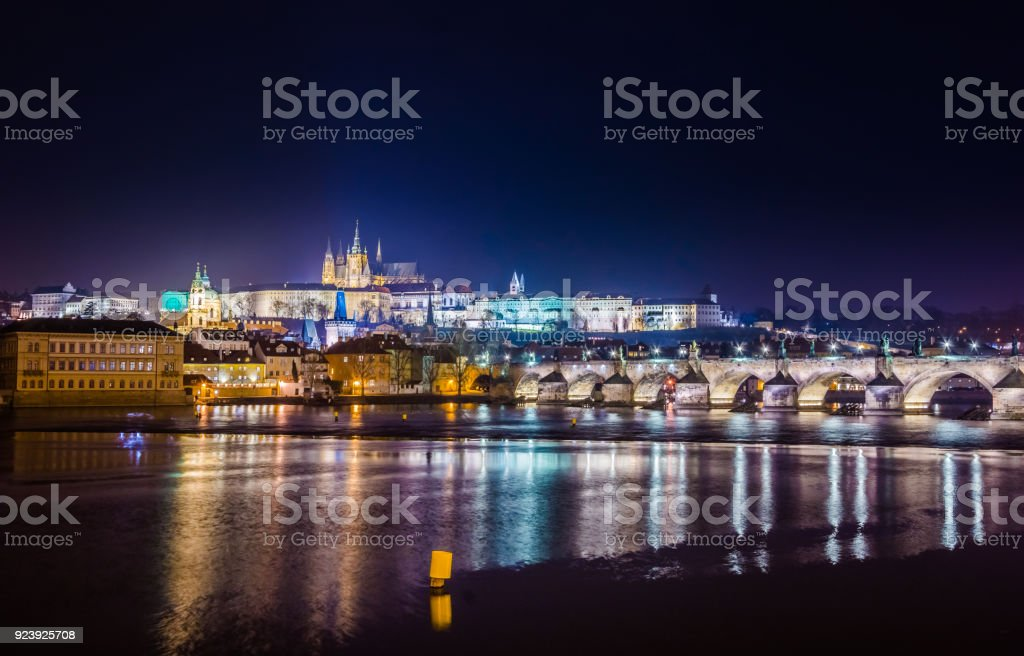 Famous Charles Bridge and tower at night, Prague, Czech Republic stock photo