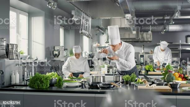 Famous chef works in a big restaurant kitchen with his help kitchen picture id824283794?b=1&k=6&m=824283794&s=612x612&h=tz 78bgoqsly i3wmzafsf3a6aodnpiu6nwslflcops=