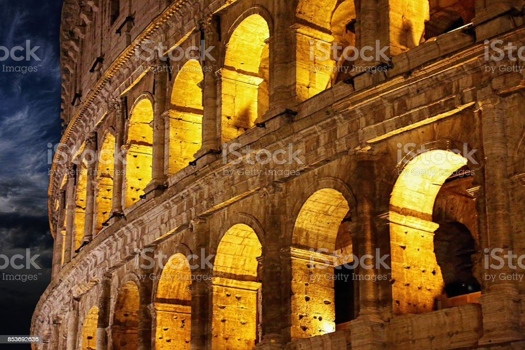 Famous coliseum of Rome at night stock photo