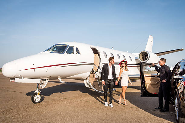 Famous couple arrived at the airport stock photo