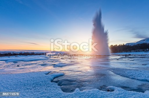 istock Famous Geysir in Iceland in beautiful sunset light 883774578
