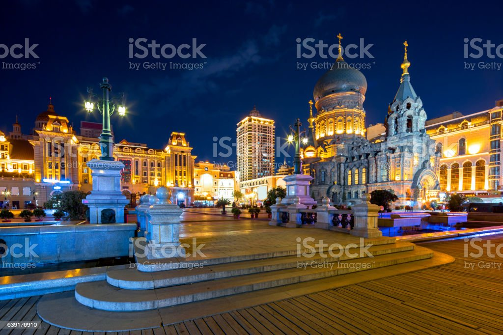 famous harbin sophia cathedral at night from square stock photo