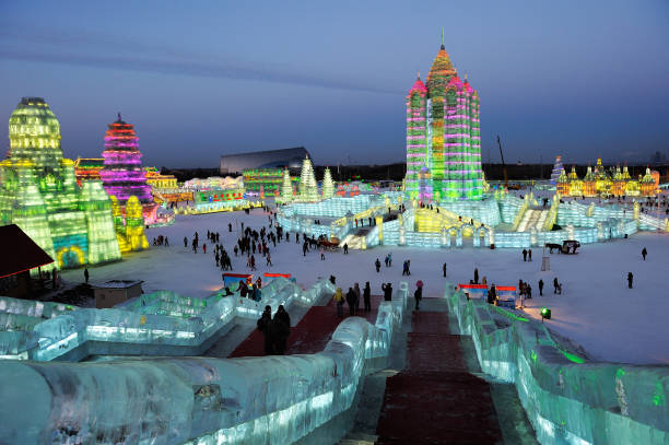 Famous Ice & Snow World Festival park with illuminated ice sculptures and structures. Harbin: Famous Ice & Snow World Festival park with illuminated ice sculptures and structures. harbin stock pictures, royalty-free photos & images