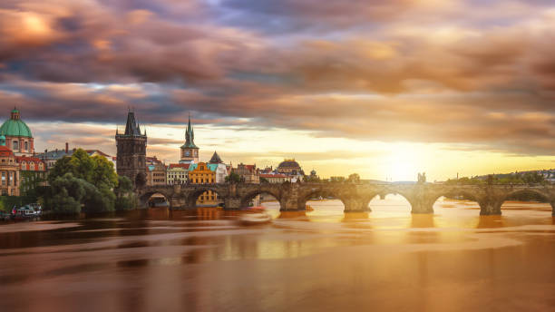 Famous iconic image of Charles bridge, Prague, Czech Republic. Concept of world travel, sightseeing and tourism. Famous iconic image of Charles bridge, Prague, Czech Republic. Concept of world travel, sightseeing and tourism. astronomical clock prague stock pictures, royalty-free photos & images