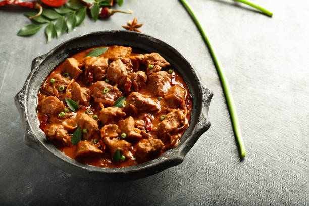 Famous Indian mutton curry roast- Popular Indian mutton curry roast -traditional recipe. curry powder stock pictures, royalty-free photos & images
