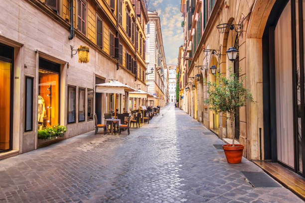 famous italian street via borgogna with shops and restaurants, rome, no people - rome road central view foto e immagini stock