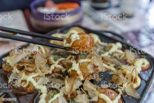 Famous japanese street food octopus takoyaki picture id871434172?b=1&k=6&m=871434172&s=612x612&h=lcxpyet8jxglbkcw2qrdvh5g8pitjbolr6xadkaa19i=