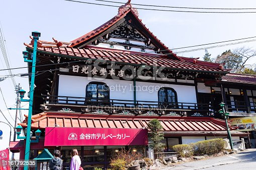 Nikko, Japan - April 4, 2019: Famous Kanaya hotel made in traditional wooden Japanese style design on street with people in Tochigi prefecture