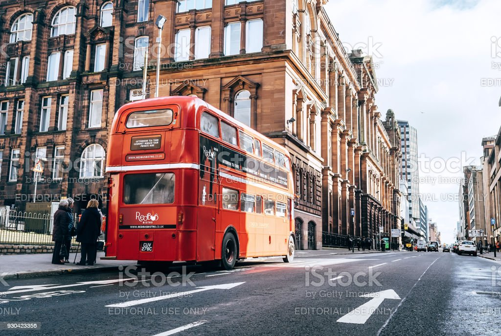 Famous London red bus as a Cafe Bus on the city street in Glasgow, Scotland, UK stock photo