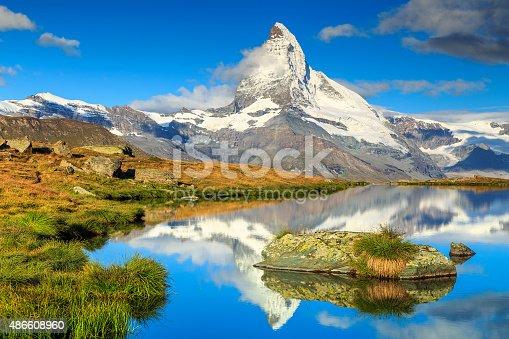 istock Famous Matterhorn peak and Stellisee alpine glacier lake,Valais,Switzerland 486608960