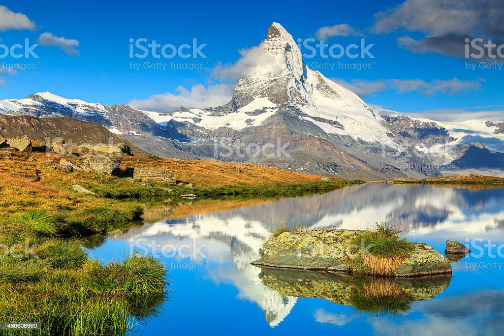 Famous Matterhorn peak and Stellisee alpine glacier lake,Valais,Switzerland stock photo