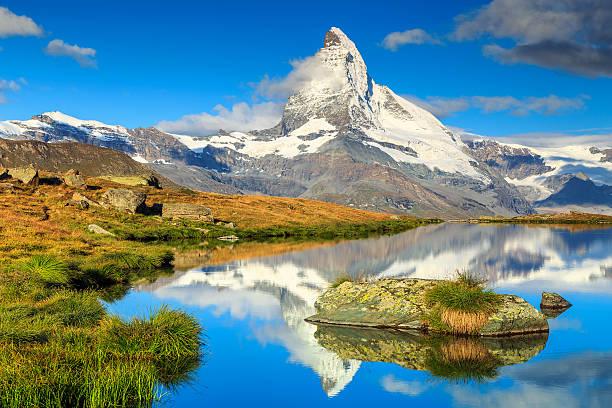Famous Matterhorn peak and Stellisee alpine glacier lake,Valais,Switzerland Stunning panorama with Matterhorn and beautiful alpine lake,Stellisee,Valais region,Switzerland,Europe swiss alps stock pictures, royalty-free photos & images