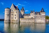 Sully Sur Loire, France - April 13, 2019: Famous medieval castle Sully sur Loire, Loire valley, France. The chateau Sully sur Loire dates from the end of the 14th century and is a prime example of medieval fortress.