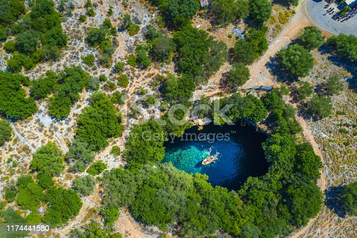 823335112 istock photo Famous melissani lake on Kefalonia island, Greece 1174441580