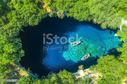 823335112 istock photo Famous melissani lake on Kefalonia island, Greece 1174443631