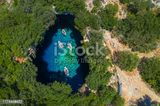 823335112 istock photo Famous melissani lake on Kefalonia island, Greece 1174446422