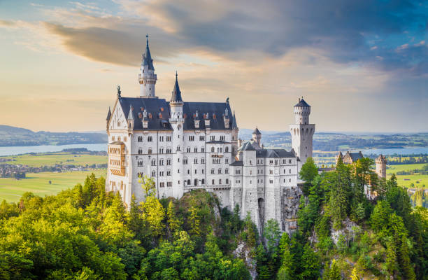 Famous neuschwanstein castle with scenic mountain landscape at sunset picture id690043834?b=1&k=6&m=690043834&s=612x612&w=0&h=xodziquigxpnzchpfaq2vn 7ron3hatq3z2ow4aexea=