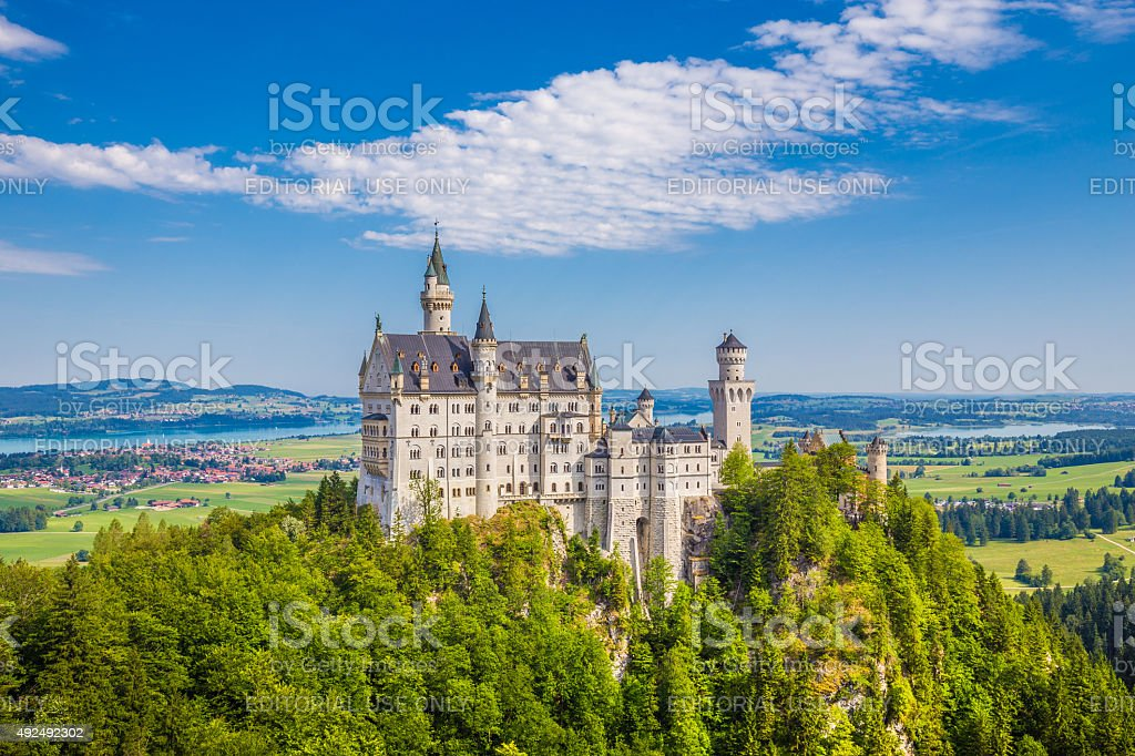 Famous Neuschwanstein Castle with scenic mountain landscape near stock photo