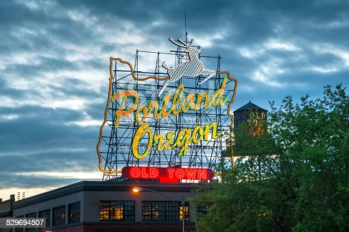 Portland, USA - May 6, 2014: Famous Old Town Portland, Oregon neon sign in the night.