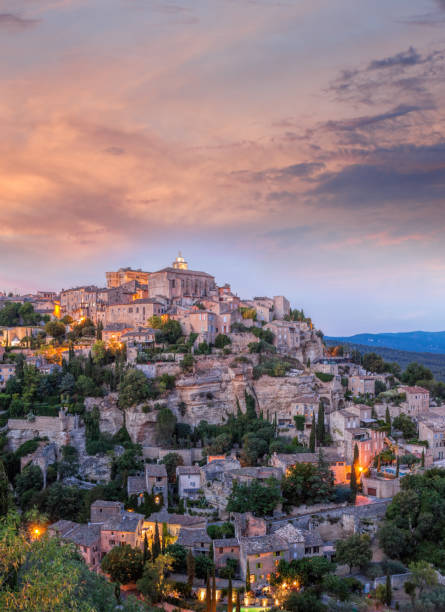 Famous old village Gordes in Provence against sunset in France stock photo