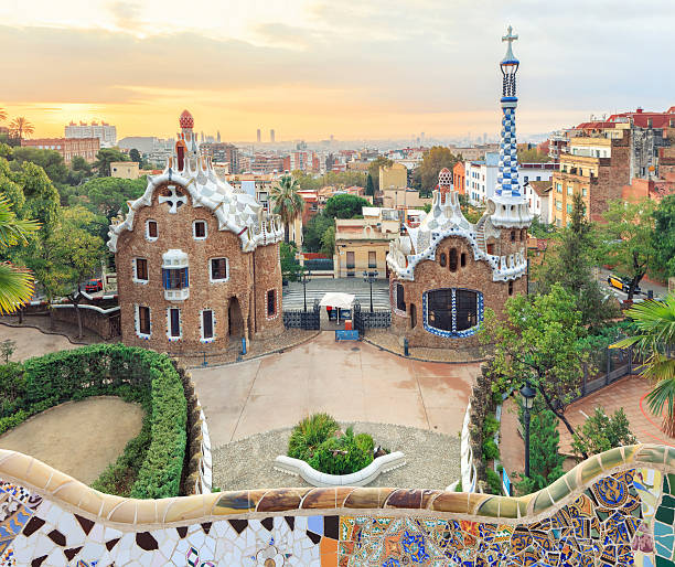 Famous Park Guell, Spain Park Guell in Barcelona. View to entrace houses with mosaics on foreground gracia baur stock pictures, royalty-free photos & images