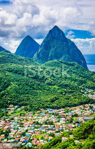 The village of Soufrière, Saint Lucia is nestled in the valley below the famous Piton Mountains.