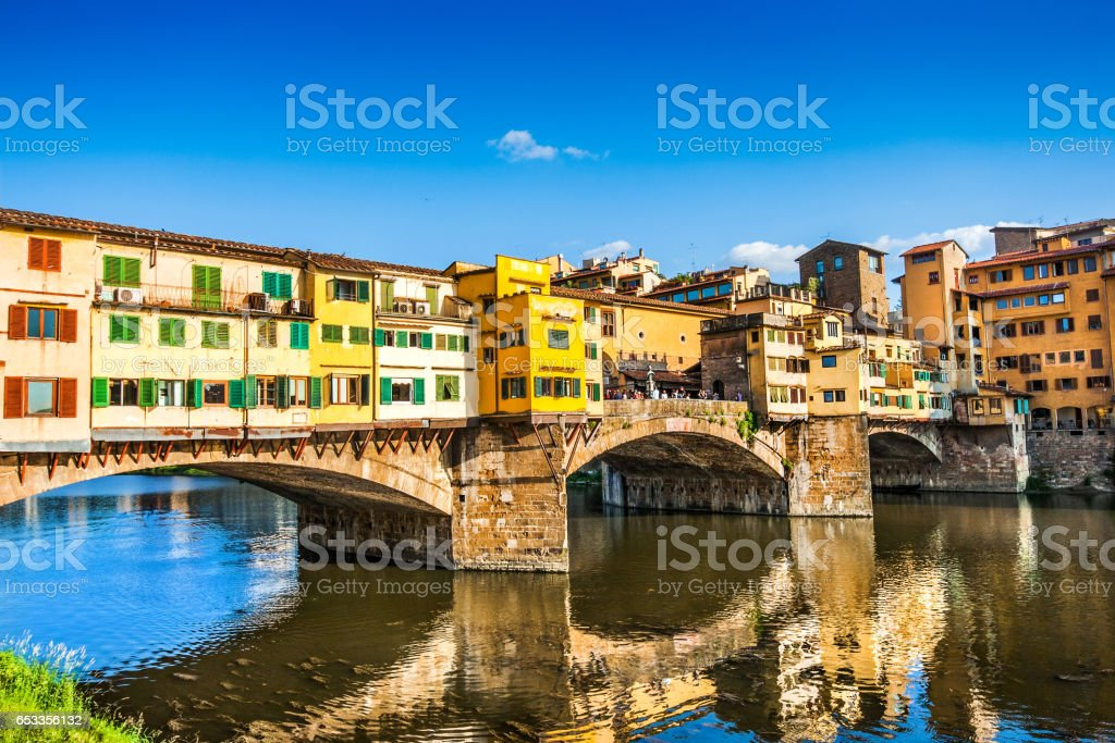 Famous Ponte Vecchio with river Arno at sunset in Florence, Italy stock photo