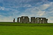 Stonehenge is a prehistoric monument in Wiltshire, England, two miles west of Amesbury. It consists of a ring of standing stones, each around 13 feet high, seven feet wide, and weighing around 25 tons
