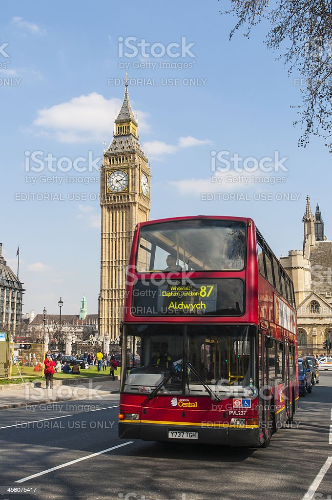 Famous red double-decker at Houses of Parliament royalty-free stock photo