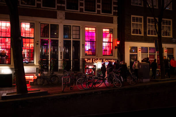 Famous Red light District city nightlife in Amsterdam. stock photo