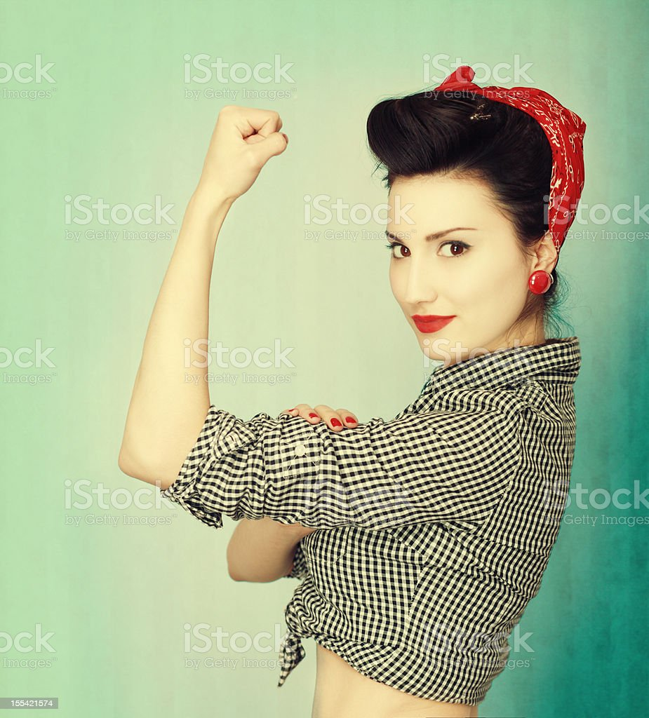 Famous retro Rosie Riveter pose poster stock photo