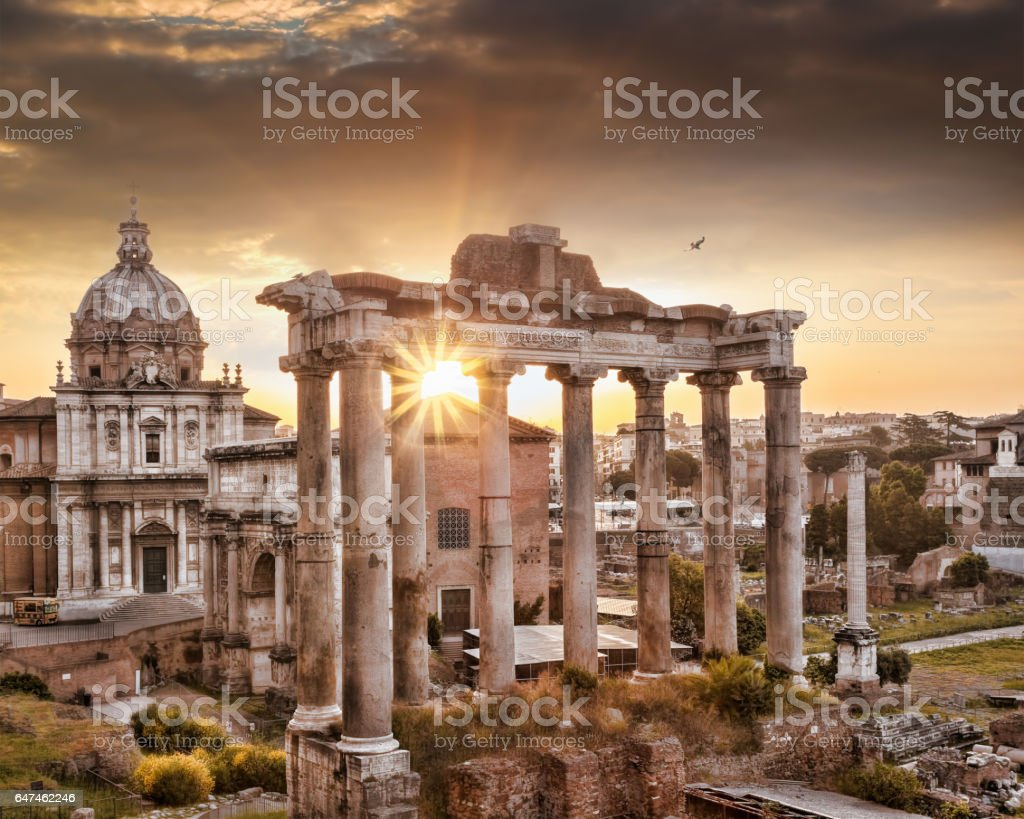 Famous Roman ruins against sunrise in Rome, Italy stock photo
