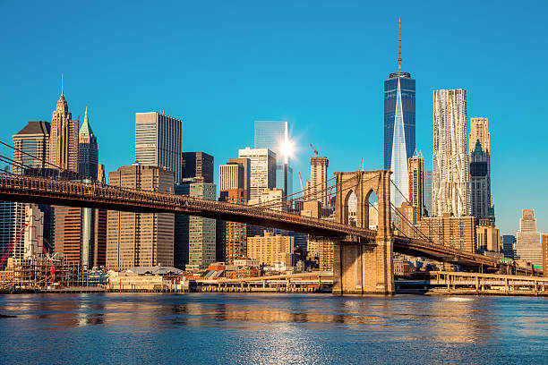 famous skyline of downtown new york city at early morning - ny fotografías e imágenes de stock