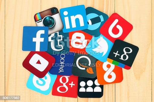 istock Famous social media icons printed on paper on wooden background 506177562