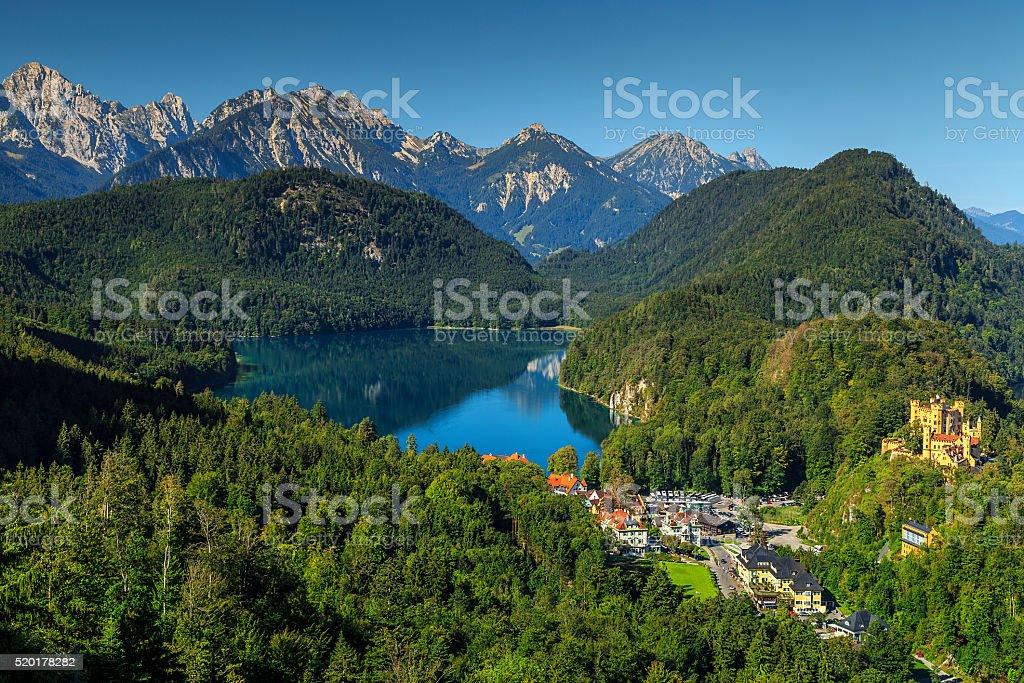 Famous spectacular Hohenschwangau castle and high mountains in background,Germany stock photo