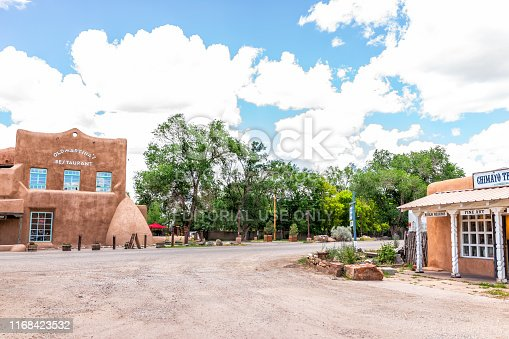 Ranchos de Taos, USA - June 19, 2019: Famous St Francic Plaza in New Mexico with Old Martina's restaurant and road