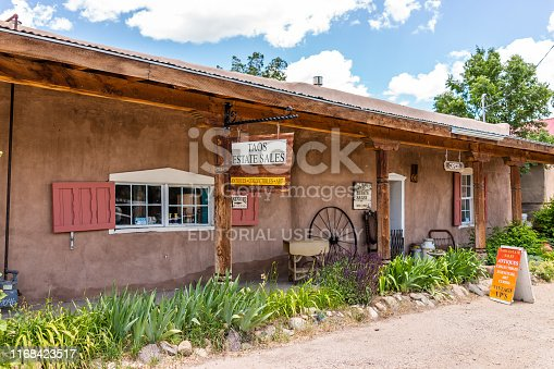 Ranchos de Taos, USA - June 19, 2019: Famous St Francic Plaza in New Mexico with Taos Real Estate business store