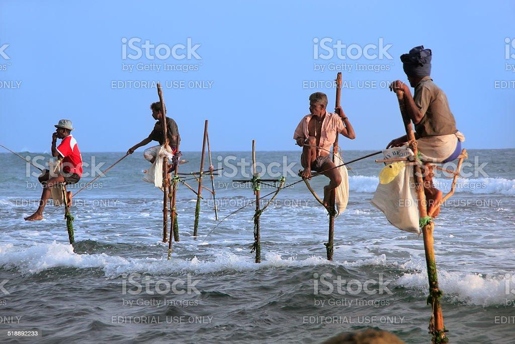 Famous stick fishermen in Unawatuna, Sri Lanka stock photo