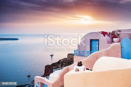 istock Famous sunset on Santorini island, Greece 648526206